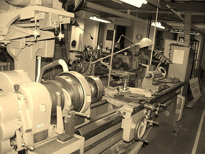 """I decided to transform this image I snapped of anique lathe into an """"older syle"""" photograph to set the mood. The lathe is a belt driven un-named unit, but in exceptional condition for its' age. This machinery is located in the basement of Allegheny Observatory in Riverview Park, Pittsburgh, PA."""