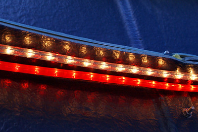 The primary lighting is provided by red and white rope lights mounted under a wall flange to provide indirect light.