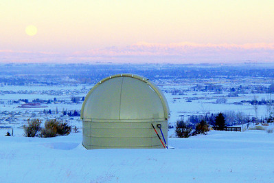 Eagle Rock Observatory on a mid-winter morning.  In the background to the West are the full moon, the Lost River Range (far left), and the Lemhi Range.  In the foreground is the Snake River Plain.