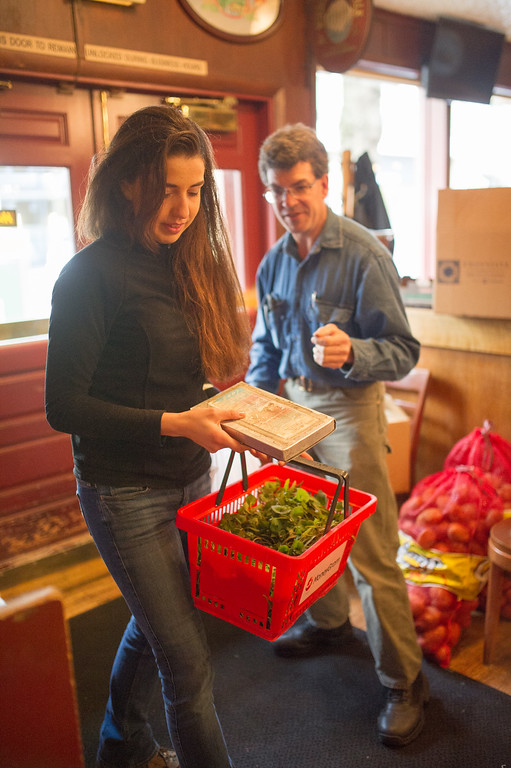 Patrick Theil and daughter Omega deliver fresh greens to Higgins Restraunt in Portland.