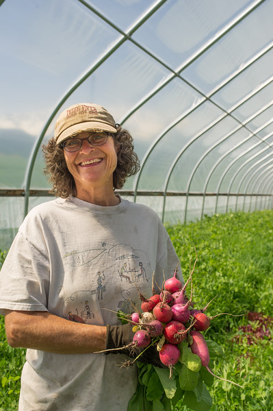 Beth Gibbons and fresh radishes. Root crops--especially carrots- are among her favorite things to grow.