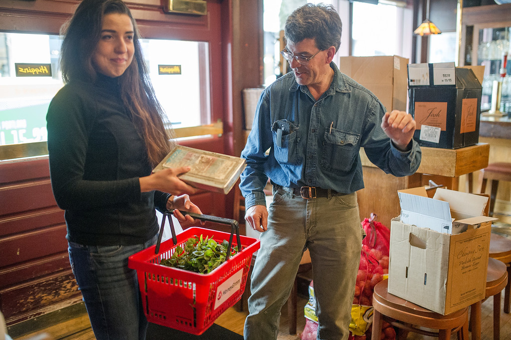 Patrick and daughter Omega deliver fresh greens to Higgins Restraunt in Portland.
