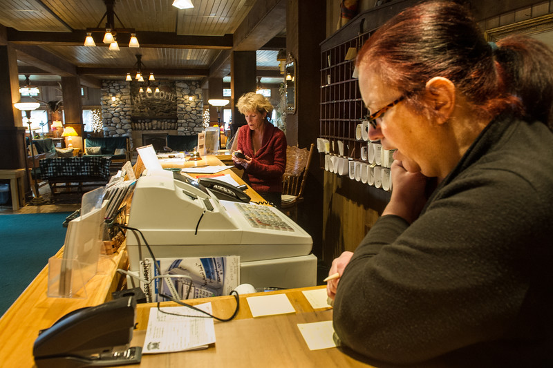 10. Office manager June Newburn (right) sets up a new electronic connection with the Bank of Eastern Oregon whle General Manager Laura Cosgrove  makes a phone call to check on a guest's reservation request.