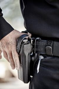 police officer law enforcement man with gun closeup