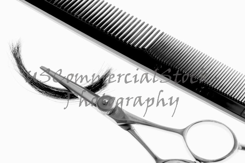 Haircutting scissor with lock of hair