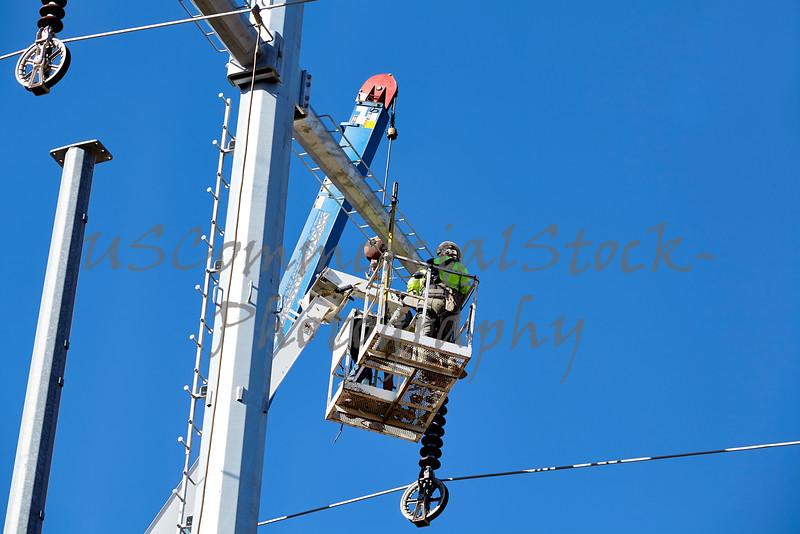 High voltage power line tower crane workman