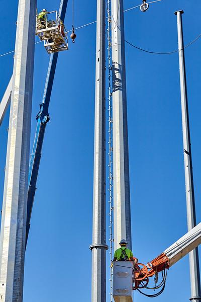 High voltage power line tower crane workers men