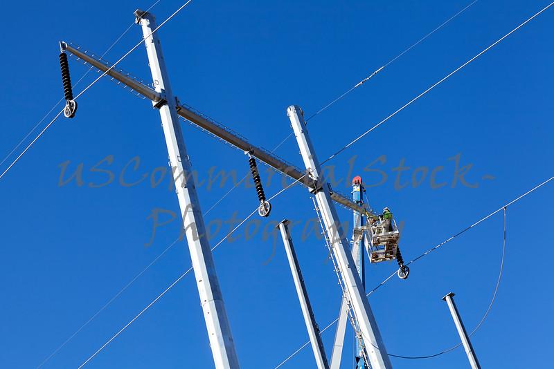 High voltage power line tower crane lineman