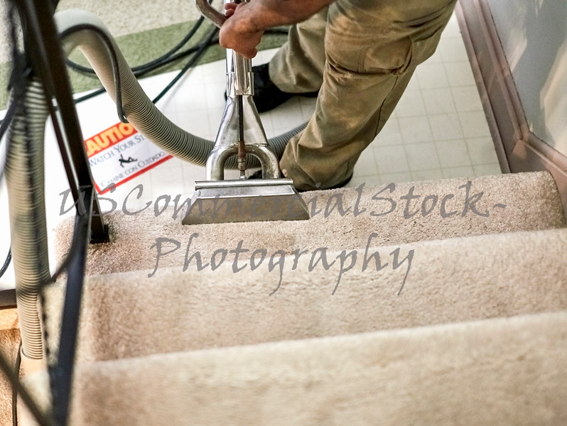 Professional Carpet Cleaner workin on the Stairs