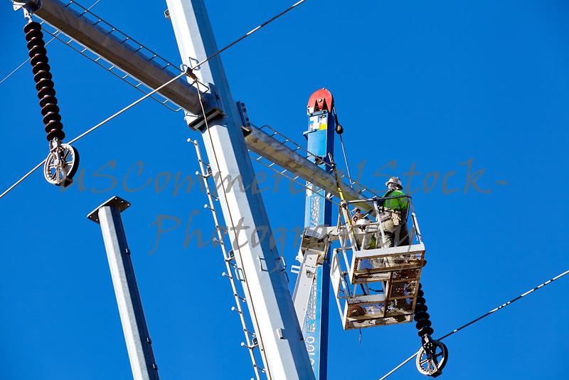 High voltage power line tower crane men