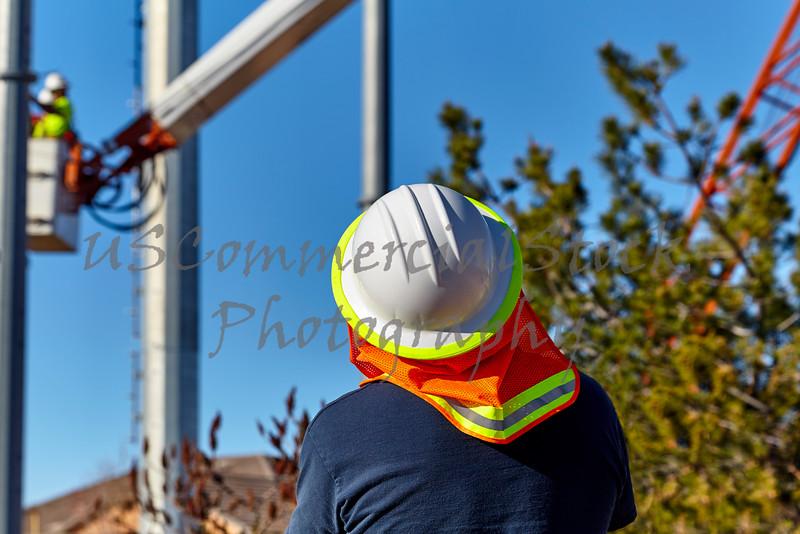 Utility LIne Worker installing a Power Pole