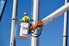High voltage transmission line tower crane men