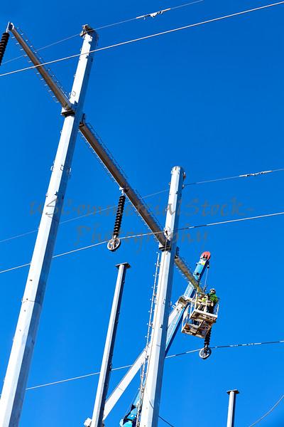 High voltage transmission power line tower crane men