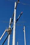 Editorial High voltage power line tower crane workers men