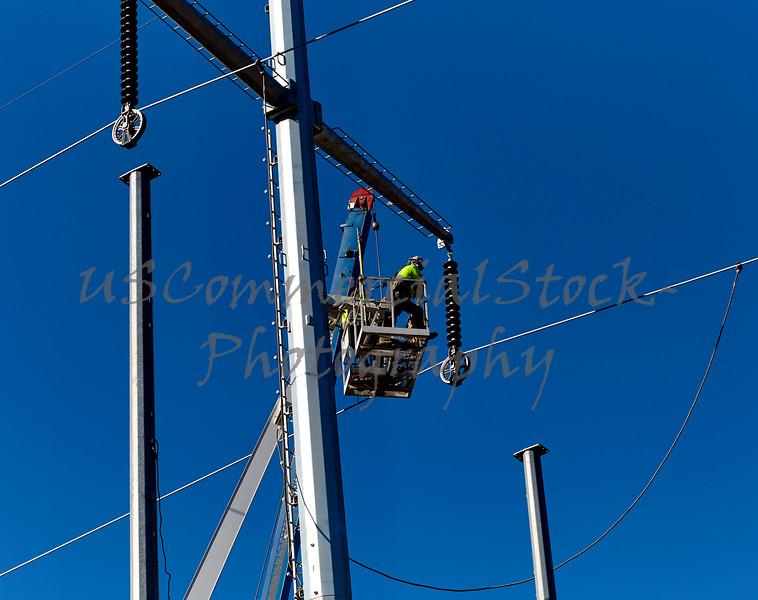 Utility Line Worker in Boom Crane basket