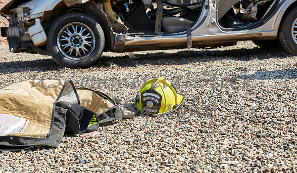 Firefighter Helmet and Jacket on the Ground