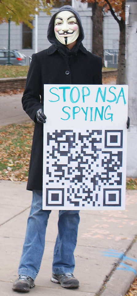 """""""Million Mask March"""" protester expresses opposition to government spying by the NSA."""