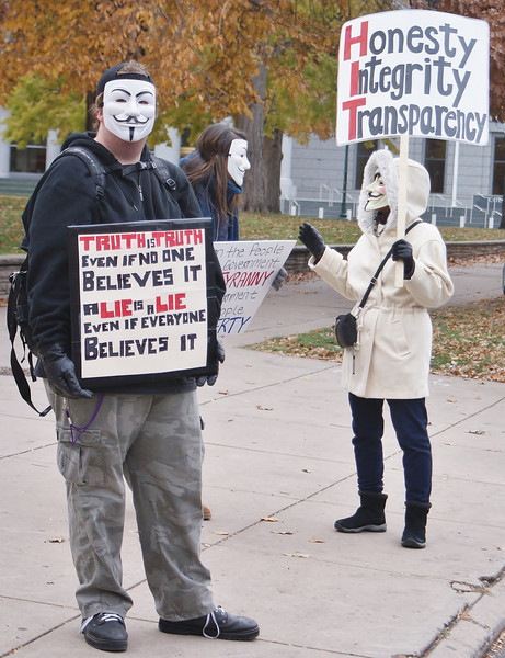 """""""Million Mask March"""" protesters gathered near the state capitol building in Denver and later marched through the city's downtown area."""