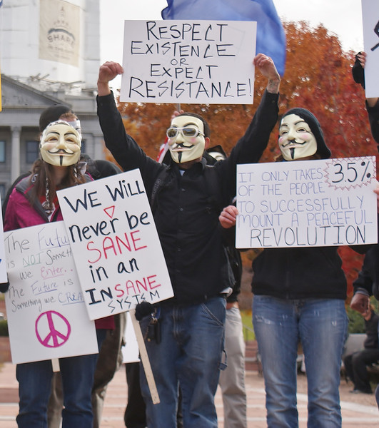"""Million Mask March"" protesters gathered near the state capitol building in Denver and later marched through the city's downtown area."