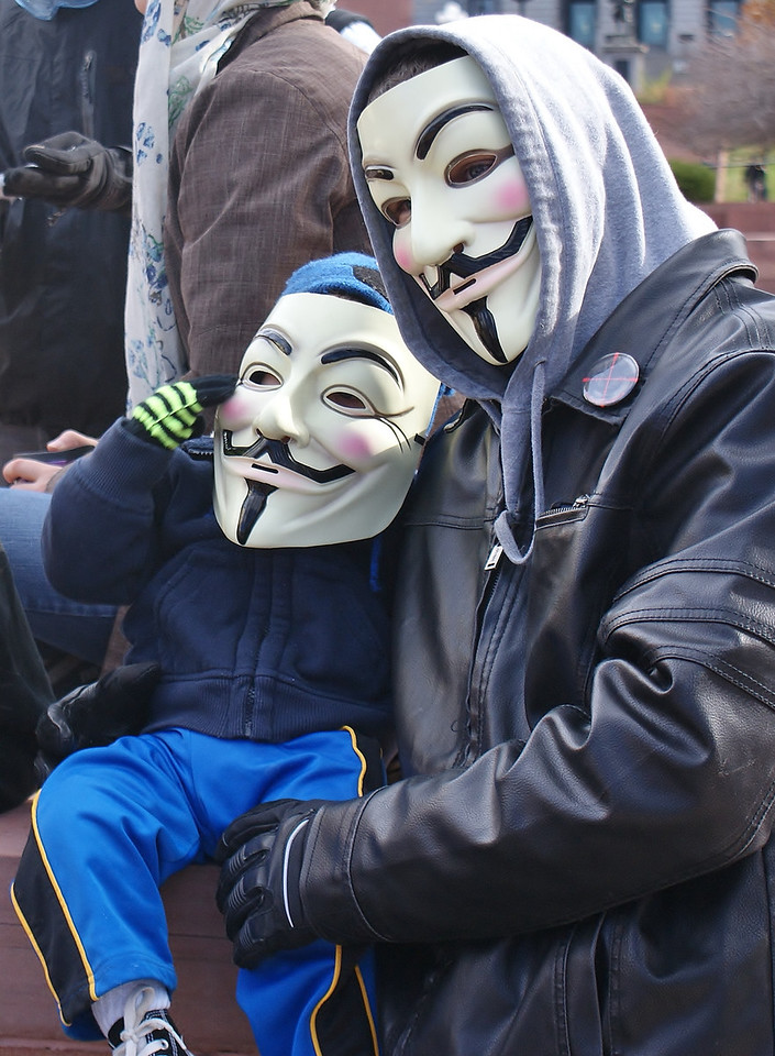 "Parents with small children were among protesters joining the ""Million Mask March"", in Denver. (11/5/13)"