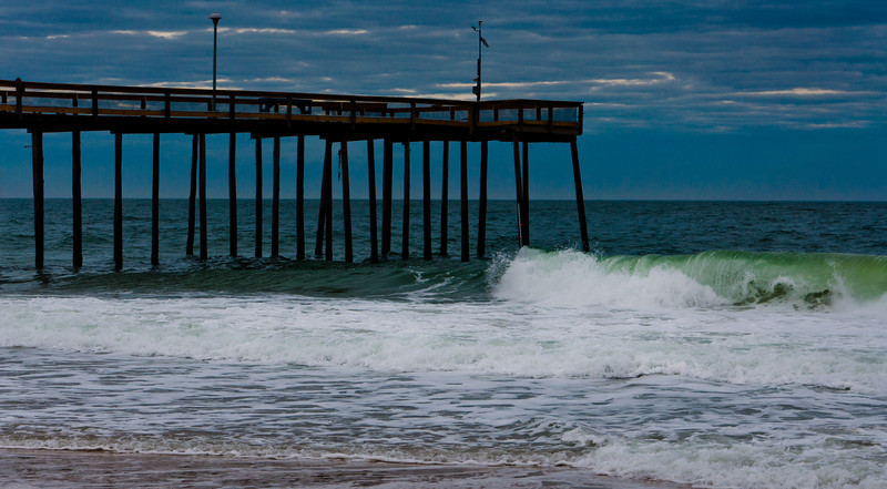 Waves crash on the pier on a stormy evening, Ocean City, Maryland