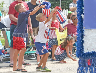 [on left] Jack and [in middle] Lance Dobrosielski, from Maryland, trying to catch candy with their hats. Fourth of July/150th anniversary parade in Ocean Grove, NJ on 7/6/19. [DANIELLA HEMINGHAUS | THE COAST STAR]