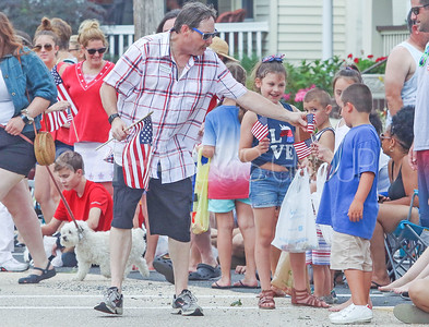 Deputy Mayor Robert Lane handing out flags. Fourth of July/150th anniversary parade in Ocean Grove, NJ on 7/6/19. [DANIELLA HEMINGHAUS | THE COAST STAR]