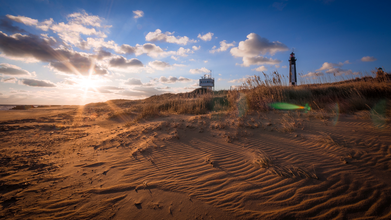 Sand Ripples and a Lighthouse