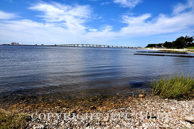 Biloxi Bay Bridge viewed from Ocean Springs beach. The isle Casino can be seen on the far left side of the picture at the end of the bridge.