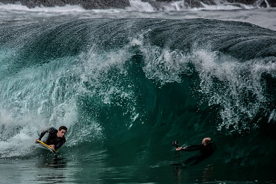 Smile for the camera. Body boarder making the turn and photographer shooting.