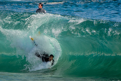 Body surfers at the Newport Wedge both looking but, in difference directions...