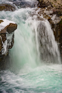 Small Waterfall with Icicles and Snow