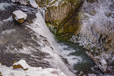 Waterfall with Icicle, frozen Plants, Boulders and Fallen Log