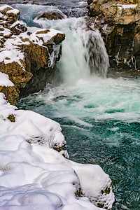 Snow and Icicles around Waterfall and Pool