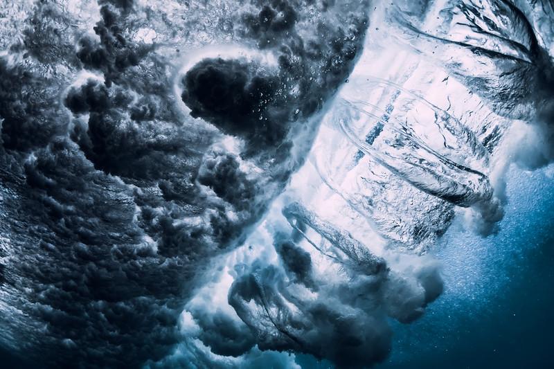 Barrel wave underwater with air bubbles. Ocean in underwater
