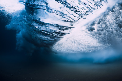 Underwater wave crashing in ocean. Transparent water underwater