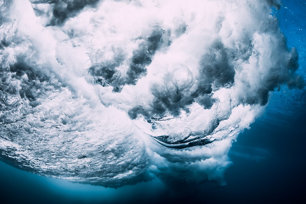 Ocean wave underwater. Blue ocean in underwater