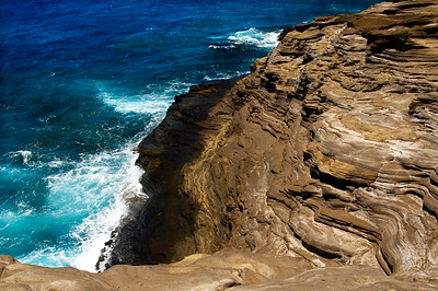 Portlock Cliffs  Beautiful, breathtking and treacherous, the cliffs on the southwest point of O'ahu, are made of tuff (volcanic ash). With years of erosion, the look of these cliffs is soft, wavy and smooth.
