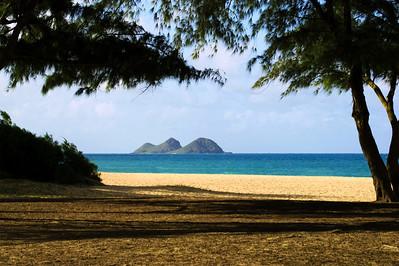 "Waimanalo State Beach Park Looking north is the Mokapu Peninsula and the Mokulua (or ""the Mokes"") Islands   Soft white and powdery sand against the bright turquoise water of Waimanalo Bay  O'ahu, Hawai'i"