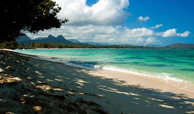 Waimanalo Beach has some of the most beautiful bright turquoise water, and powdery soft, white sand.  Makapu Peninsula in the background from Waimanalo Beach Windward Oahu, Hawaii