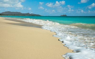 "Waimanalo Beach Looking north is the Mokapu Peninsula and the Mokulua ""Moks"" Islands   Soft white and powdery sand against the bright turquoise water of Waimanalo Bay  O'ahu, Hawai'i"