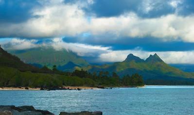 Olomana Peak is an intra-caldera, part of the Ko'olau volcano that formed the Ko'olau Mountain Range Many afternoons are covered in clouds on the Windward coastline Waimanalo, Oahu, Hawaii