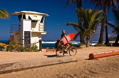 Sunset Beach Lifeguard Tower, Biking along the North Shore Bike Path, carrying a surfboard