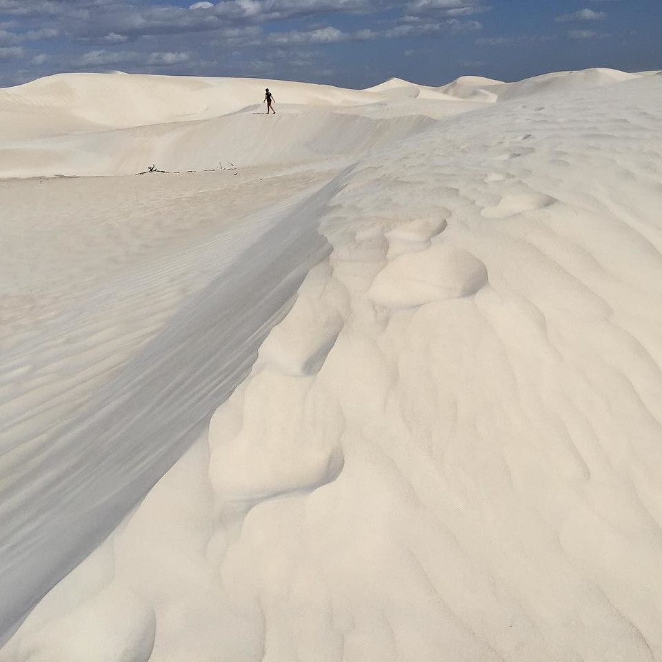 "Where's Audrey? The sand dunes of Nambung National Park, just south of Cervantes, Western Australia en route to the town of Lancelin. ""Maybe I should pull over. I want to check these dunes out."" So glad we did, just by chance. Parked the camper van, walked a bit. And the earth opened white and wide. Incredible. Some of the world's softest sand, clean and bright, drifting in Mother Nature's artful ways. This area may not be much on tourist maps, but it was one of my favorite spots among many from our past several days along the Indian Ocean Drive and the Western Australia coast. via Instagram http://ift.tt/20IQJcg"