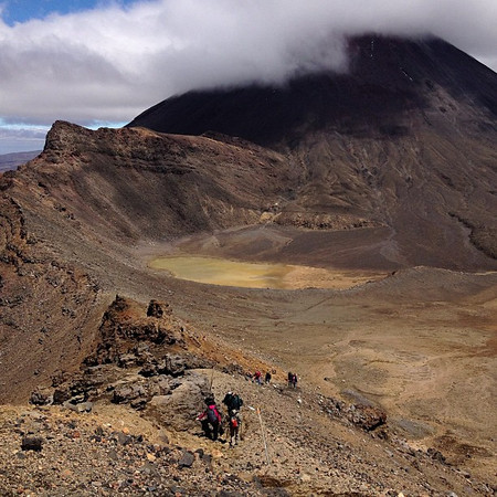 Mordor, tiny people as the clouds close in. Mt. Ngauruhoe, Tongariro Crossing #newzealand
