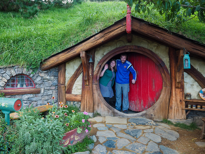 Amanda and Elliot in a hobbit hole in Hobbiton