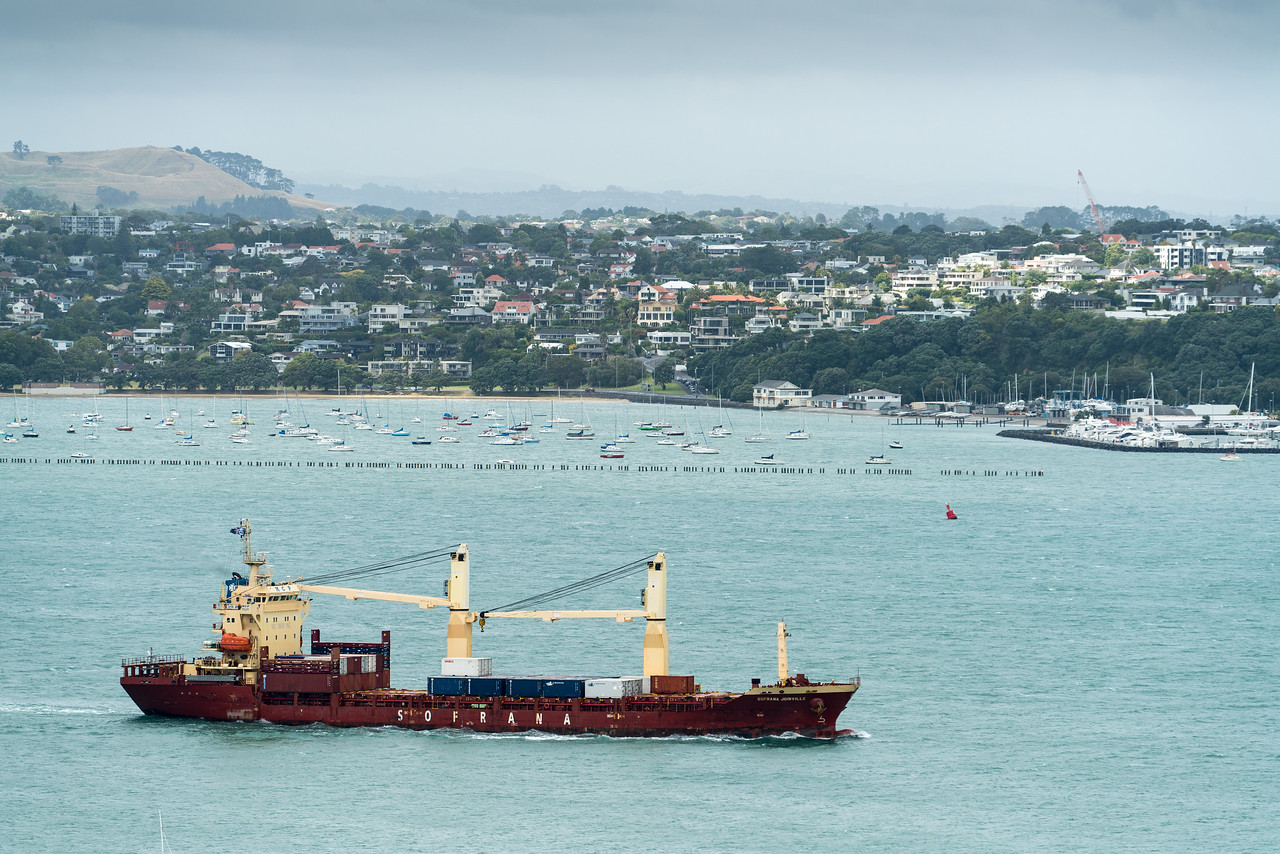The container ship Sofrana Joinville steams into Waitematā Harbour.