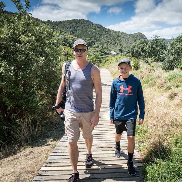 Tim and Madoc on the path to Piha Beach.