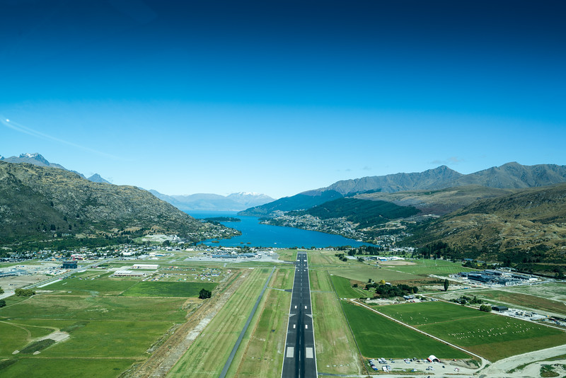 Looking west down the main runway in Queenstown towards the Frankton Arm and out to Lake Wakatipu.