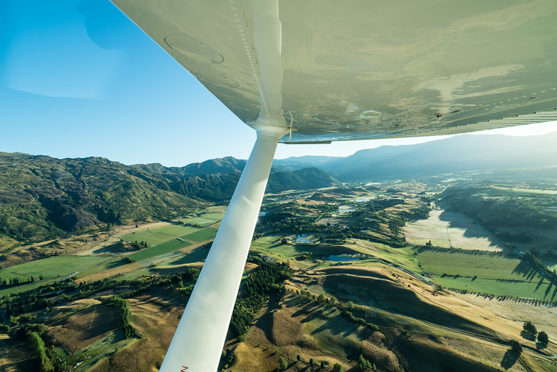 Climbing out of the Queenstown airport, looking out across Speargrass Flat.